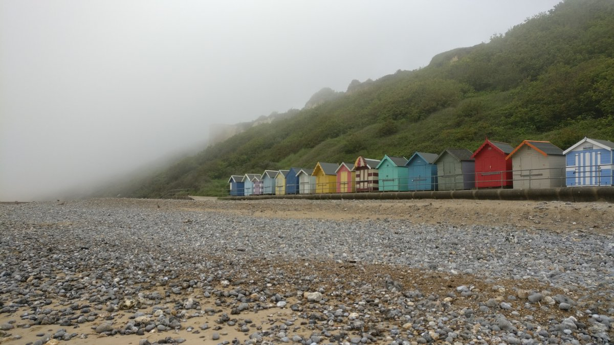 Cromer beach huts and mist