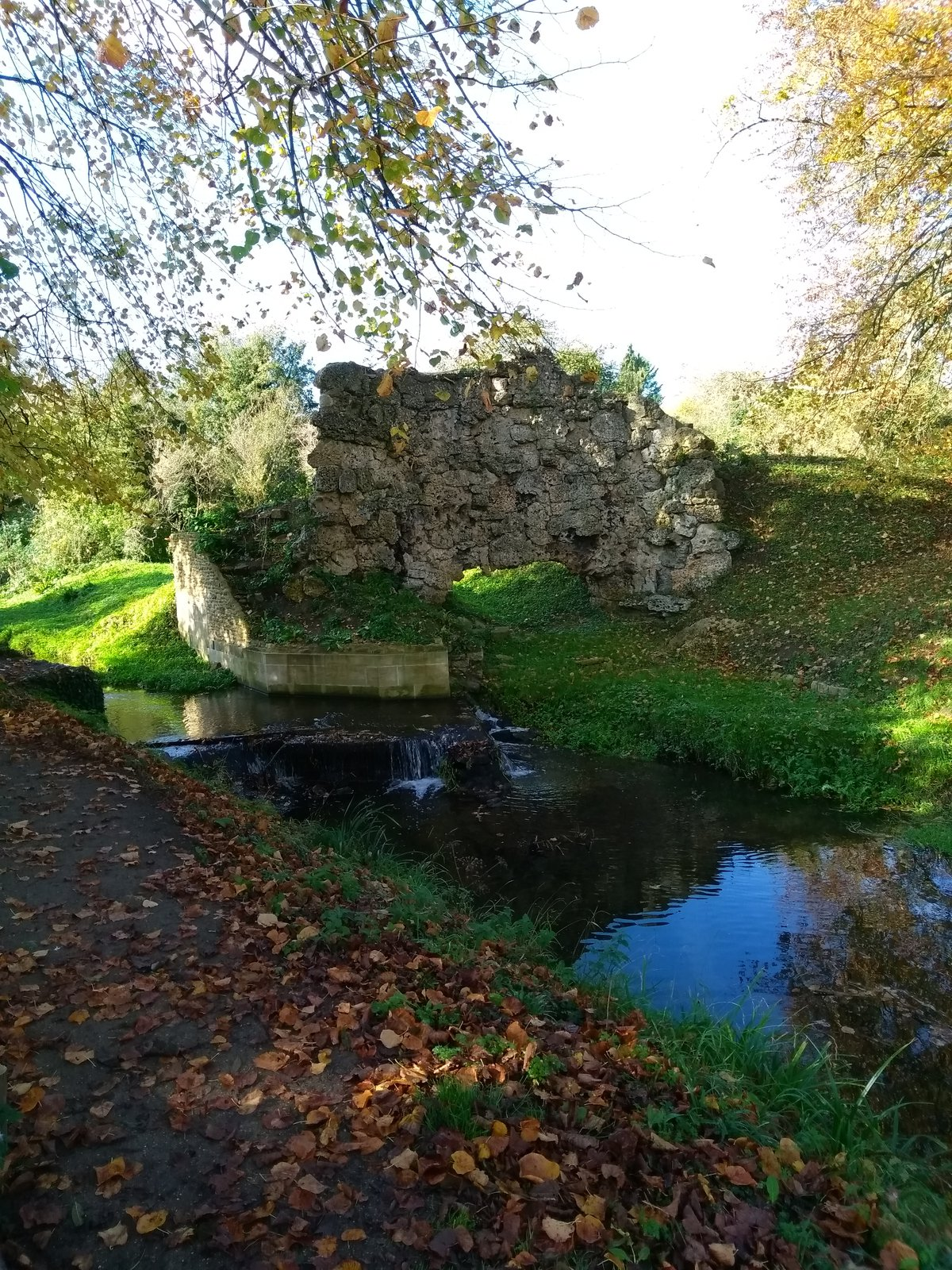 Autumn sun on ruins and a river