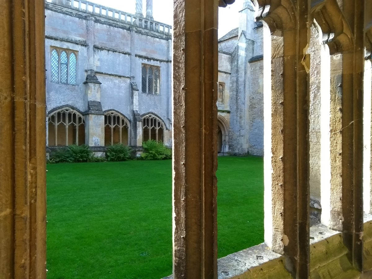 View through stone windows at Lacock Abbey