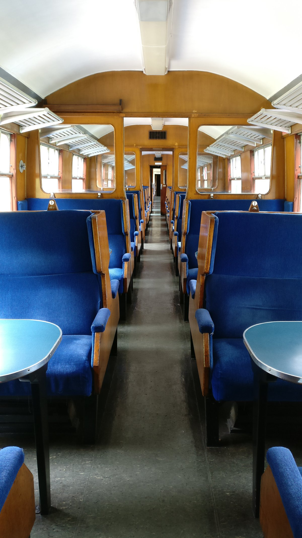 Inside old, open train carriage